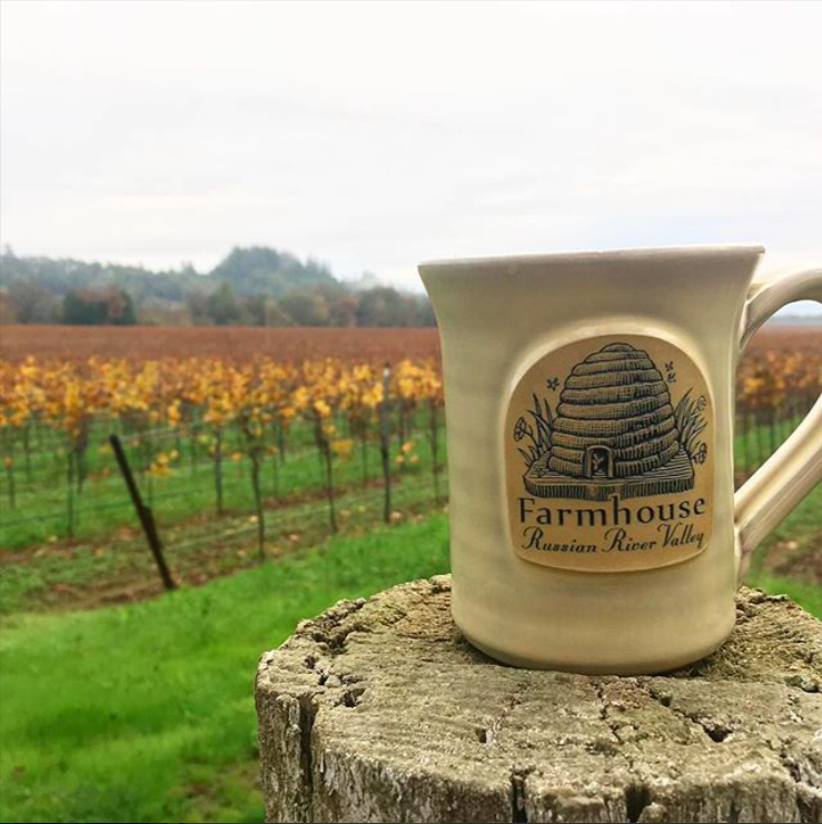 farmhouse inn mug in the field